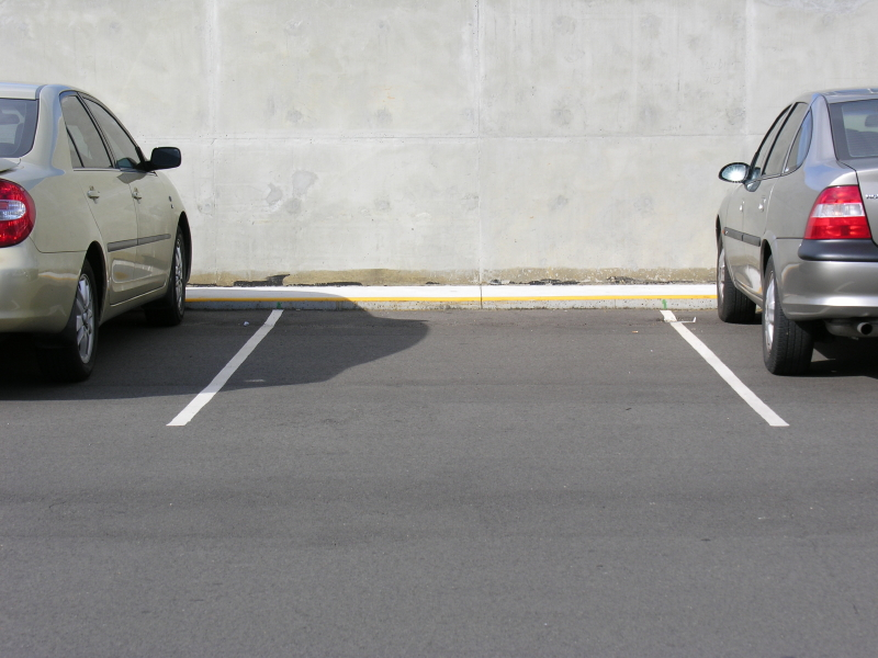 Parking lot with a spare parking space